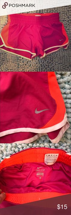 Nike running shorts 💗❤️ Brand new condition Nike running shorts in pink & orange! Nike Dry fabric built to wick sweat. Elastic waistband, mesh side vents, convenient inner pocket (pictured), lined. Nike Shorts