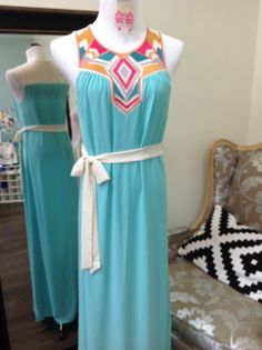 """This maxi is so pretty and feminine with a splash of bright colors!  You can even wear a """"normal"""" bra with it - no hiding the straps! Tie it in the front, side, or back or no belt needed.  https://www.facebook.com/pages/Sister-Kates-of-Spring-Hill/219037054932386"""