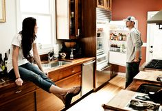 08/04/11.  RYAN VOGELSONG and wife Nicole in their kitchen.  This is one of those photos that just invites creative captioning.  Please add your humorous captions below!!!  (Photo by Martin Klimek for USA Today)