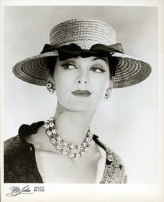 Carmen Dell Orefice in hat by Mr. John, 1955