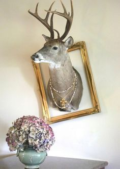 If I have to live with his taxidermy at least I can make it funky! Cow Skull Decor, Deer Decor, Dear Head Decor, Modern Cabin Decor, Deer Mounts, Deer Design, Love Your Home, Oh Deer, Furniture Arrangement