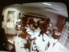 This picture was taken of a nurse's viewing monitor. On the monitor a black figure appeared standing on top of the patient who was lying in the bed. The patient died within a few hours of this figure appearing.