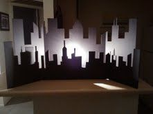 City skyline cut out of tri-fold project board. This is going in the baby's super-hero room!