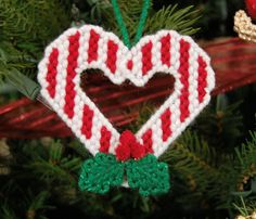 Candy Cane Ornament on plastic canvas by Strings Away! Candy Cane Crafts, Candy Cane Ornament, Plastic Canvas Ornaments, Plastic Canvas Crafts, Plastic Canvas Stitches, Plastic Canvas Patterns, Christmas Crafts, Christmas Ornaments, Christmas Patterns