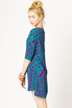 patterned shift dress. That girl needs a tan