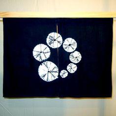 Navy blue noren with shibori spiderweb spiral by SumireDesign, $70.00