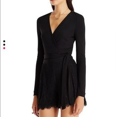 DVF Black Romper - Jersey/Lace The top of this romper made out of jersey and it's a wrap top with the shorts being Lace DVF Other
