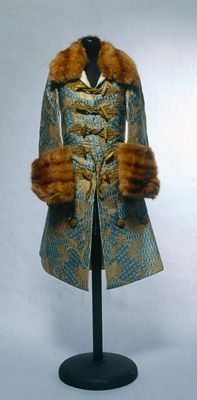 Men's suit for indoor use. Italy, about 1740-1750. Silk and gold. Seta Textile Collection. The collection donated by Count Luigi Alberto Gandini in 1881-1882 consists of more than 2,500 pieces of fabric, trim, ribbons,and lace. The collection offers a rich and varied collection of yarns, techniques and ornate textile art, mainly Italian and European art from the Middle Ages to the 19th century.