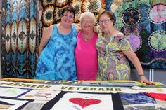 Margaret Ellis, Jan English and Jean Newman are among many partners of war veterans helping to tell their stories in a quilt to celebrate the centenary of Anzac. (Image: ABC/Blythe Moore)