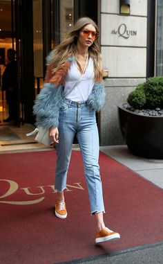 Gigi is spotted wearing orange tinted sunglasses and matching shoes while out and about in New York City.