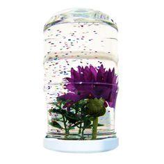 Dit is een variatie op de winterse sneeuwbol: een fleurige zomerse glitterbol. Wat heb je nodig een glazen potje met deksel hobbylijm glitters kunststof bl