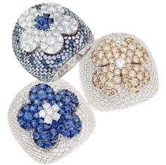 Rings in white gold and blue sapphires, white and brown diamonds