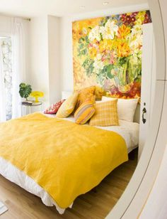 so fun! yellow bedroom + large painting above bed <3