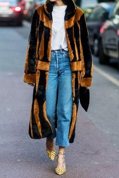 A fur coat will elevate your look! We are loving this brown and black fur coat paired with a white tee, jeans, and yellow polka dot heels.. Click for our our favorite nine options that won't break the bank. Wear them now and well into winter..