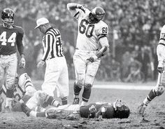 Philadelphia Eagles linebacker Chuck Bednarik (60), seen standing over Frank Gifford of the Giants after infamous hit on Nov. 20, 1960, died at age 89. (JOHN G. ZIMMERMAN/SPORTS ILLUSTRATED/GETTY IMAGES)
