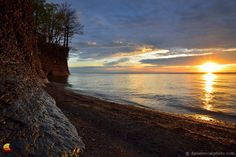 Quiet Sunset over the Lake, Hamburg Beach, New York: ... What a location it is! Right in the back yard by one of the Great Lakes and with some impressive cliffs right at the water's edge giving it the look of an attractive faraway vacation destination ... #etbtsy #buffalony #hamburgny #landscapephotography #sunset #lakeerie
