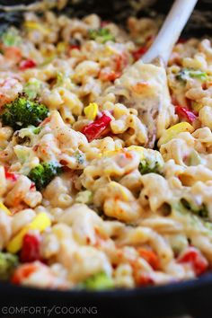 Spicy Roasted Vegetable Macaroni and Cheese  1 cup broccoli florets, chopped into small chunks 1/2 red pepper, diced 1 yellow squash, quartered and diced 10 baby carrots, sliced thinly 2 cups whole wheat pasta (elbow macaroni, rotini, penne, etc.) 1/4 cup olive oil 1 garlic clove, minced 3 Tbsp. all-purpose flour 1 1/2 cups milk 2 cups (8 oz.) Sargento® Shredded Sharp Cheddar Cheese 1/2 tsp. crushed red pepper flakes 1/2 tsp. cayenne pepper Salt and pepper, to taste 2 Tbsp. panko breadcrumbs
