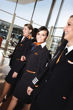 On the Way - Europe by easyJet Two flight attendants and the lady on the far right is The Captain (check out the wings and begin counting those four stripes ) Airline Uniforms, Airline Tickets, Air Hostess Uniform, Easy Jet, Flight Bag, Intelligent Women, Military Women, Girl Photography Poses, Air France