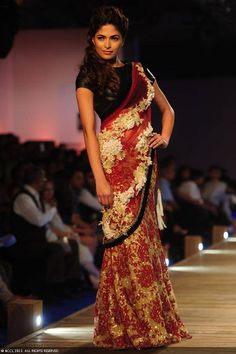 Former Miss India Parvathy Omanakuttan showcases a creation by designer Monisha Jaising on Day 2 of Delhi Couture Week, held in New Delhi, on August 01, 2013. #India #Fashion