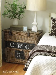 I like the unexpected use of the large French basket as a bedside table.  It gives the room another layer of texture.