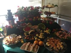 Fruit fondue, cheese cascade, fruit cascade, Shrimp cocktail, deviled eggs, spinach dip and fresh bread, Christmas party, appetizers,catering, festive.