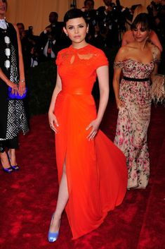 Orange may be big for the season but that doesn't make it easier to rock on the red carpet. But, with her simple makeup and super-short cut, Ginnifer Goodwin totally impressed in this Monique Lhullier gown. Also amazing? Her ability to mix-and-match with those eye-catching Brian Atwood pumps. Photo: PatrickMcMullan.com #refinery29 http://www.refinery29.com/met-gala-dresses#slide-8