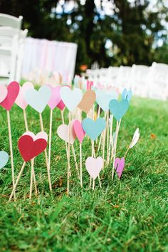 adorable!! hand made paper heart cut outs to walk down the aisle to.