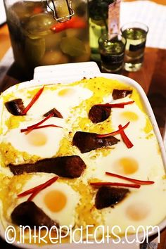 """In it's original Romanian name """"Taci si inghite"""", this dish it's all about history. Posh polenta, because it has cheese, bacon & sausages, also eggs on top."""