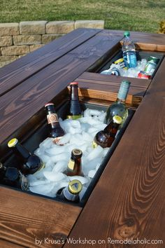 Build a patio table with built-in drink coolers from planter boxes. This is so…