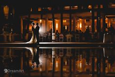 Bride and groom pose for portrait during their wedding reception at Playacar Palace in Playa del Carmen, Mexico. Photo courtesy of #DreamArtPhotography. Special thanks to @prweddings