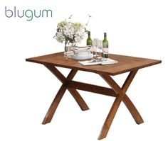 Buy Transitional Flat ‪Wooden‬  ‪DiningTable‬ http://www.blugum.com/seating/transitional-flat-wooden-dining-table-with-crossed-legs-for-support.html?___SID=U