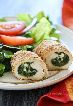 Chicken cutlets stuffed with spinach, feta and ricotta, then breaded and baked to perfection!  I love making stuffed chicken breast as many as you probably figured out by now. You can stuff chicken with just about anything, and leftovers can be frozen and reheated for your very own homemade frozen meals which are so much better than store bought.     Anyone can make these, there are no toothpicks required and the prep time is fairly quick. I served this with a great big salad on the side…