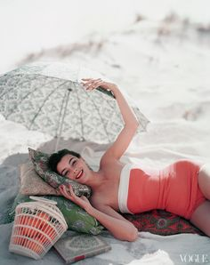 Vogue beach shot, retro, one piece swimsuit, umbrella