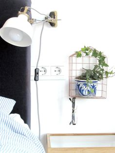 bedside table styling, wire basket, ikea, blue, white, gold