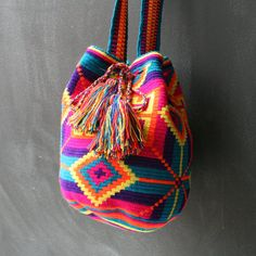 To purchase original Wayuu Bags, visit… Tapestry Bag, Tapestry Crochet, Mochila Crochet, Potli Bags, Ethnic Bag, Boho Bags, Craft Bags, Knitted Bags, Crochet Fashion