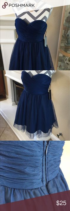 """Navy Tulle Strapless Party Dress Pretty Tulle Strapless party dress with sweetheart neckline. Hidden zipper.  27"""" long. Underlace and overlay.  Perfect for a special occasion or night out.  Brand new with tags. Lulu's Dresses Mini"""