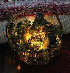 Fairy village in a log basket