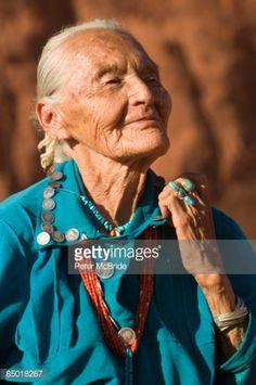 A Navajo rug weaver.