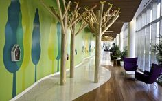 Portland Children's Hospital: Tree theme; windows; Small to Tall colors; decals with small flat screen/artwork.
