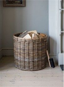 The Large Holkham Log Basket is crafted in thick kubu rattan with added rope detail