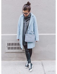Baby blue needn't always look so soft and powdery. Give it a tougher spin with moody gray knits and black leather. Click through to shop the look.