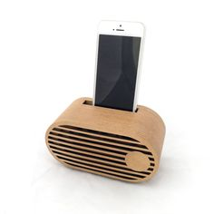 Voxbox Classic - Diagonal Front - With Phone - White Background VoxBox Smartphone amplifier is a non-powered passive speaker