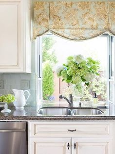 Pretty kitchen valance adds a country French look.