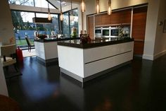 wood flooring kitchen The Pros and Cons of Hardwood vs. Laminate Wood Flooring