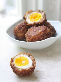 Scotch Egg = a boiled egg inside a fried sausage ball. Add some ketchup for the perfect breakfast treat.