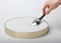 Lick it Clean is a round plate that also features an elasticated surface and stretches when pressure is added, allowing the user to scoop up all the food.