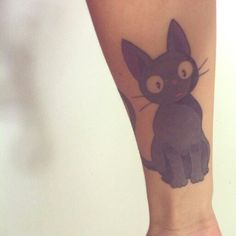 Jiji tattoo? At least it's well done; good shading and very clean lines.