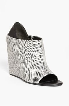 How crazy cool is this wedge bootie????