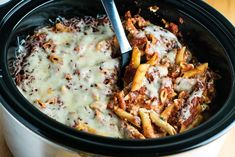 A recipe for easy crockpot baked ziti with minimal prep work. This recipe is vegetarian, comes together quickly, and the slow cooker does the work!