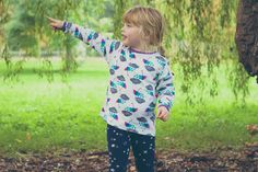 With colourful umbrellas and fluffy grey rainclouds, our Brollies and Blizzards T-Shirt will cheer anyone up on a cold and miserable day. A gender neutral print